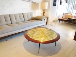 Spectacular circular coffee table with a mosaic of gilded tiling and solid Brazilian Rosewood edging on fine metal legs.