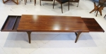 Coffee table in Brazilian Rosewood with concealed drawer at one end and extension leaf at the other