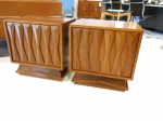 Pair of walnut side-cabinets with beautifully sculpted front panels.