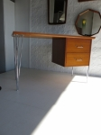 Danish small study desk in teak and chromed steel.
