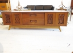 Low sideboard with carved details to front