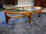 Oval shaped sculptural coffee table with glass.