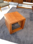 A nest of 3 tables forming a cube 